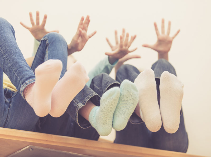 happy-children-which-are-sitting-on-the-stairs-in--PYPP7UL